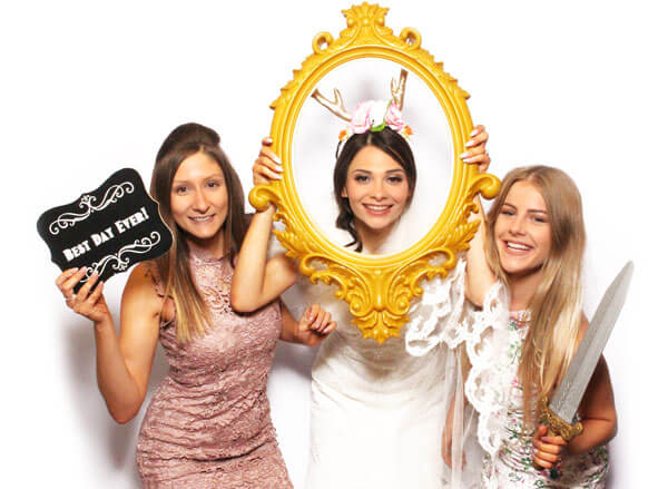 Bride in photo booth at wedding